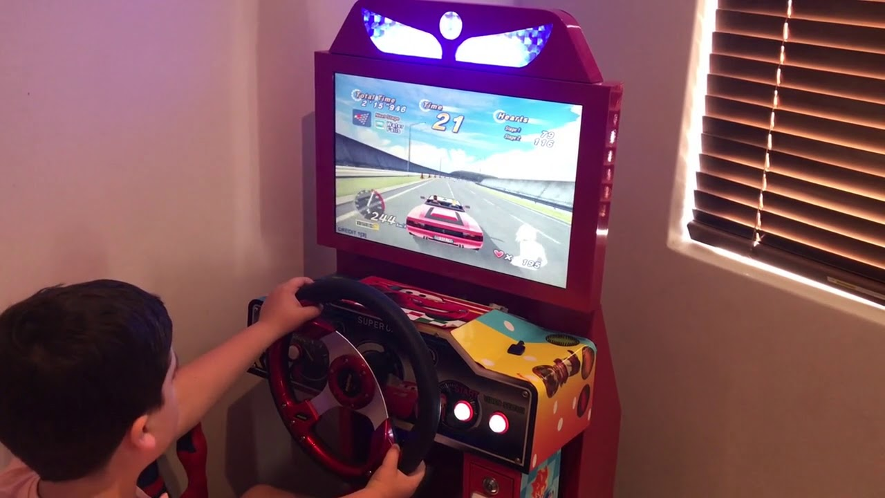 OutRun Arcade Machine Play with Young Gamer