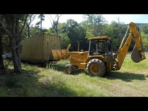 Unloading and moving a Shipping Container