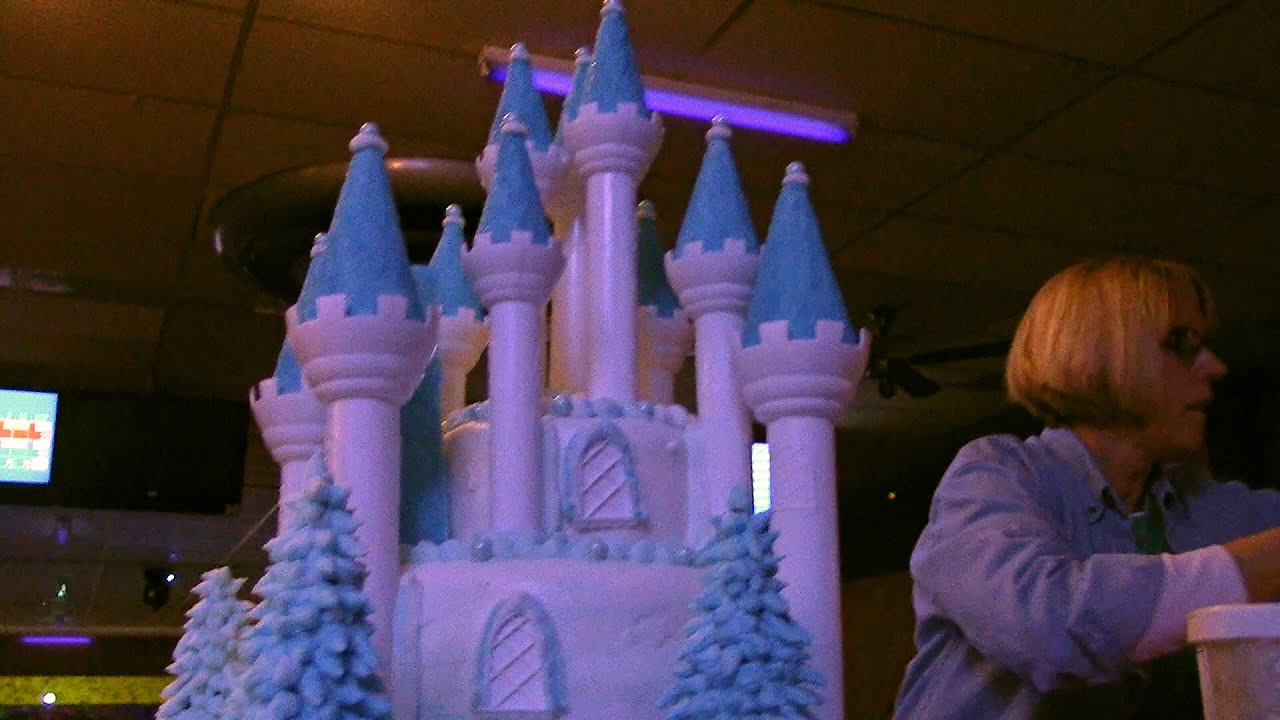 giant frozen fever castle cake - assembled and decorated at party