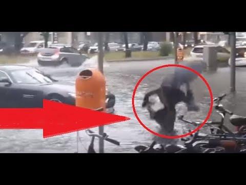 Berlin Unwetter- Frau fällt in Gulli😂😂