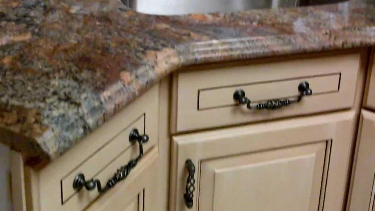 Kitchen cabinets ivory glaze finish by for Antique ivory kitchen cabinets