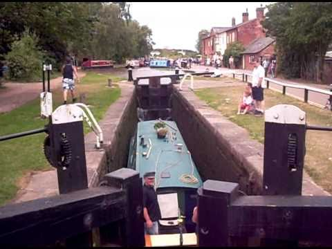 The process of moving the boats through the canal to a higher level water.
