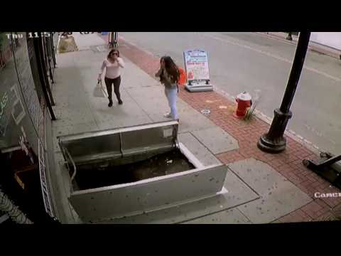 Woman Falls Into Open Sidewalk Hatch While Texting