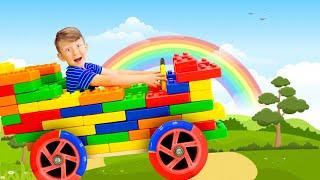 سينيا وبابا يجمعان سيارات ملونة. مجموعة سلسلة المرح