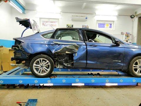 Ford Fusion Hybrid.   Небольшой удар и куча скрытых повреждений.