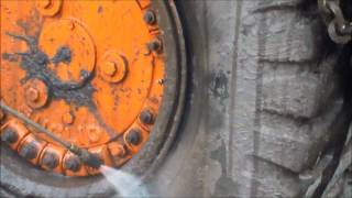 Pressure washing and acid cleaning a piece of heavy equipment, end dump, with  build up