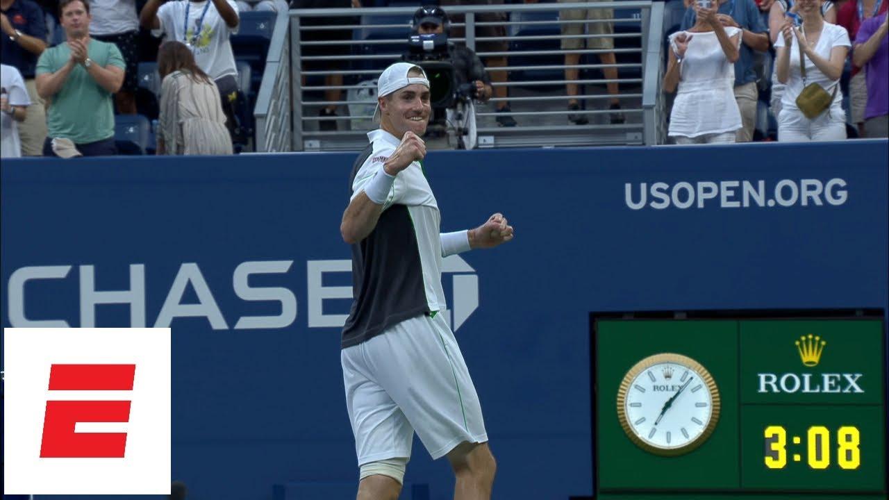 John Isner advances, defeats Milos Raonic in five sets