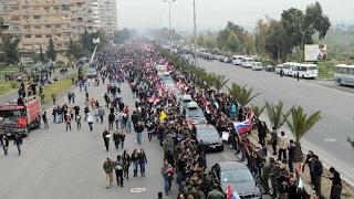شبيح من طراز رفيع يتجرأ على موكب بشار الأسد فماذا كان جزاؤه ؟ - هنا سوريا