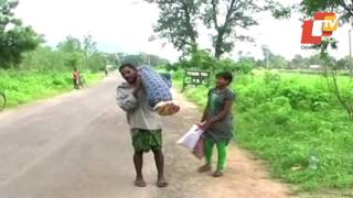 Man carries wife' in Odisha's Kalahandi district helplessly