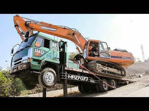 Oversize Heavy Load Transport Excavator Doosan 340 LCV by Fuso Self Loader Truck