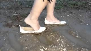 Wrong shoes in muddy country road....