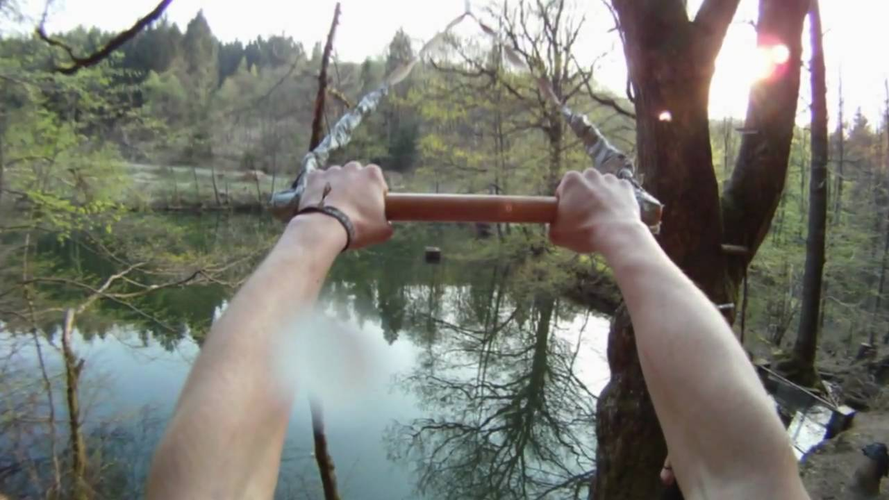 Rope swing and tree jumps into small cold lake youtube for Swing over water