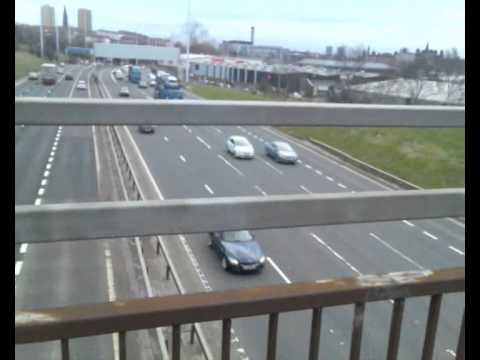 Walking on Motorway Bridge Between Sighthill & Townhead in Glasgow, Scotland