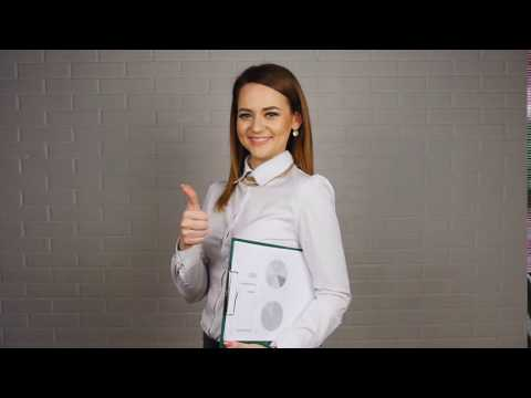 Karasmanis Business Services Group - Business woman holding documents