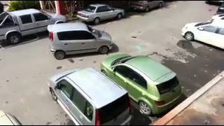 Man smashes car window to move double parked car.
