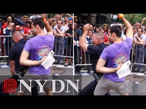 NYPD Officer Dances Enthusiastically With Pride Parade Marcher