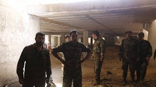 Syrian government forces find rebel weapons stockpile near Damascus