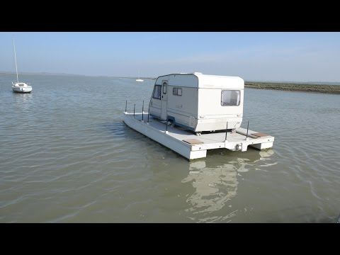Grandad who couldn't afford cabin cruiser built his own - out of caravan and raft