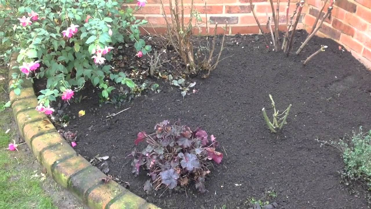 Raised flower beds tidy up top soil and bark mulch youtube for Topsoil garden soil