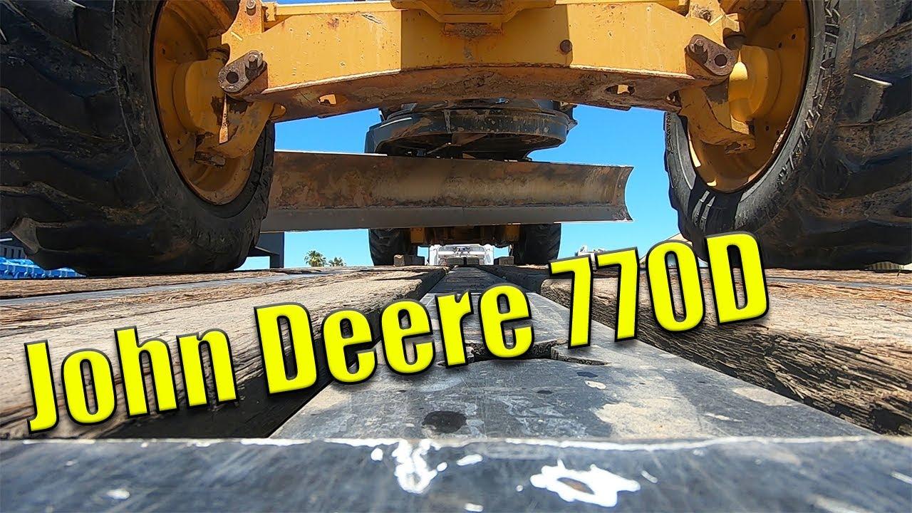 Unloading John Deere 770D Motor Grader