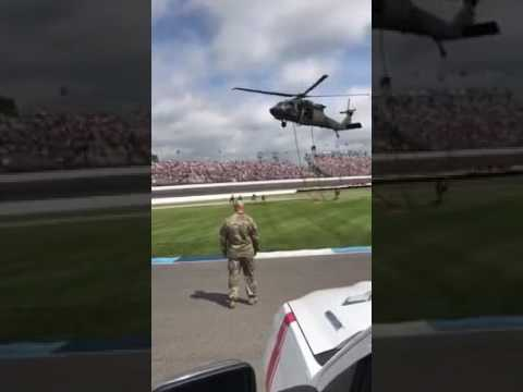 Indy 500 green flag delivered by rappelling soldiers from helicopter in Turn 4