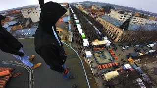 Roofing Above HUGE CROWD During Festival   POV