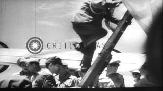 Japanese delegates reach Le Shima, Ryukyu Islands and then advance towards Manila...HD Stock Footage