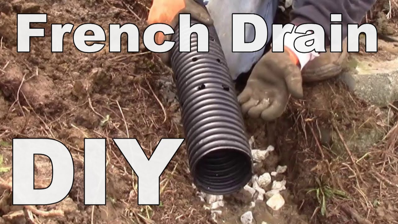 Diy corrugated pipe french drain holes point down for Drain francais interieur vs exterieur