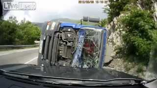 Truck tips over in curve, very close call for oncoming traffic - MUST SEE