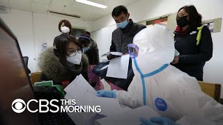 """Wuhan citizens """"freaking out"""" over coronavirus, American stranded in city says"""