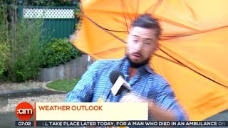 Weatherman gets (almost) blown away on Irish TV by : TheJournal.ie