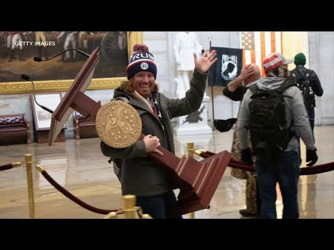 Smiling man carrying Pelosi's lectern 1 of 6 Florida men linked to U.S. Capitol siege