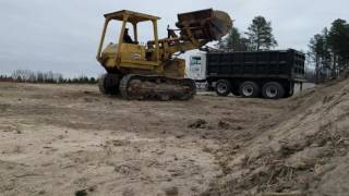Loading topsoil with Caterpillar 955L track loader