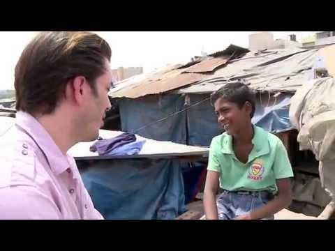 Jonathan Scott Interviews a Young Boy in an India Slum