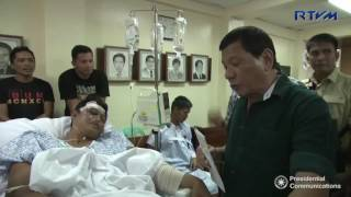 President Duterte visits soldiers and cops wounded in Marawi fighting in a hospital in Iligan City