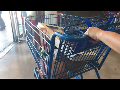 Pushing Shopping Cart Leaving Grocery Market - Free Stock Footage