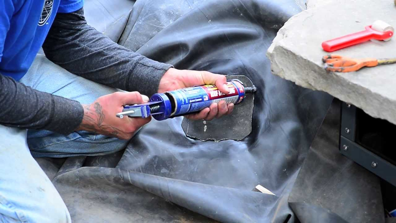 How to build a fish pond part 9 pond liner repair for Fish pond repair