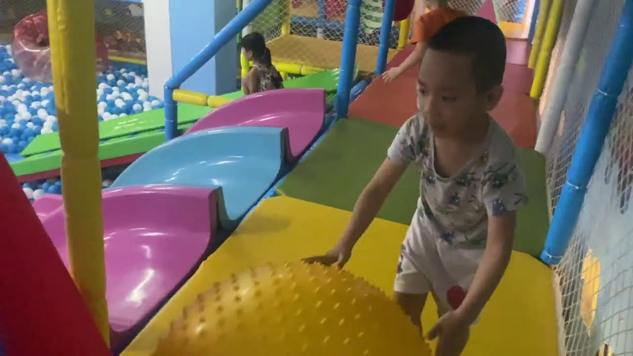 Indoor playground for kids at play center with many toys and house balls for kids, children.
