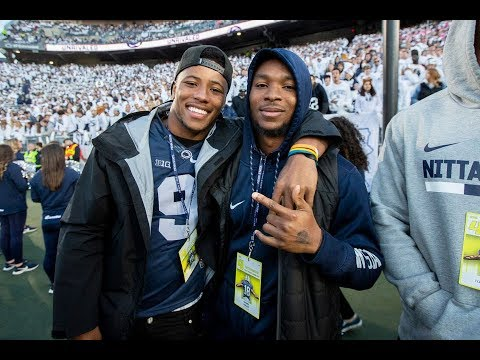 Saquon Barkley talks to young fan during Penn State's Homecoming game