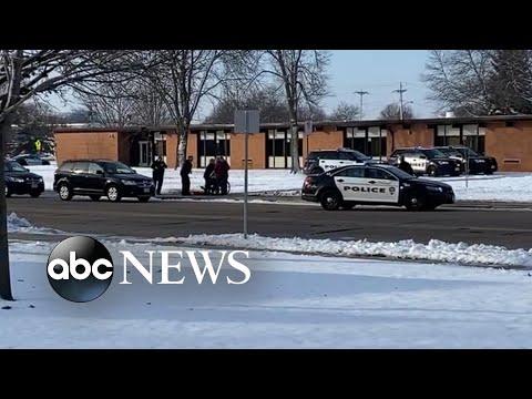 High school student shot after stabbing school officer