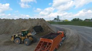 Caterpillar 980G Loading Belly Dump Trailers at a Sand and Gravel Pit