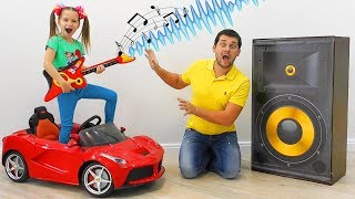 Sofia plays with Toys musical instruments and wake up Dad