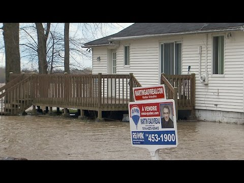 Hundreds urged to flee rapidly rising waters in Quebec