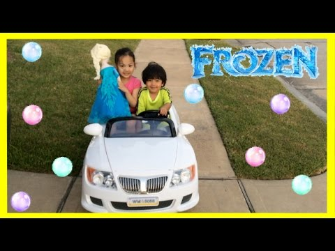 Kid Playing Outside riding car blowing bubbles with Giant Frozen Elsa Doll Ryan ToysReview