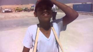 New Suez Canal, Egypt: child works with his father in selling candy and cigarettes for workers