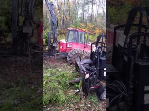Bandit chipper being fed by a valmet forwarder