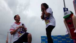 Joey Chestnut proposes to girlfriend on stage. #nathans4th