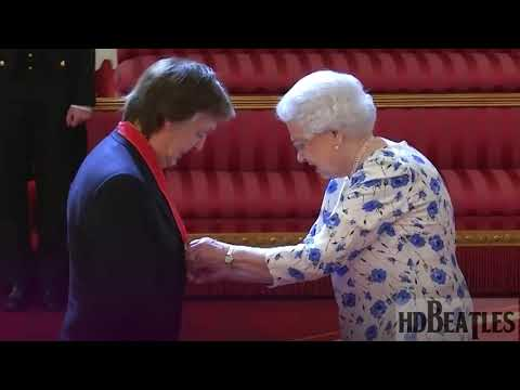 Sir Paul McCartney given the award for services to music from the Queen [Buckingham Palace, London]