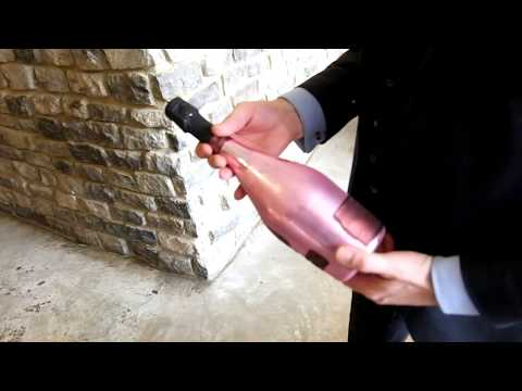 Opening a bottle of Armand de Brignac Champagne