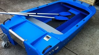 Blue Catamaran Spindrift Dinghy with Fold up Wheels & what it is worth info